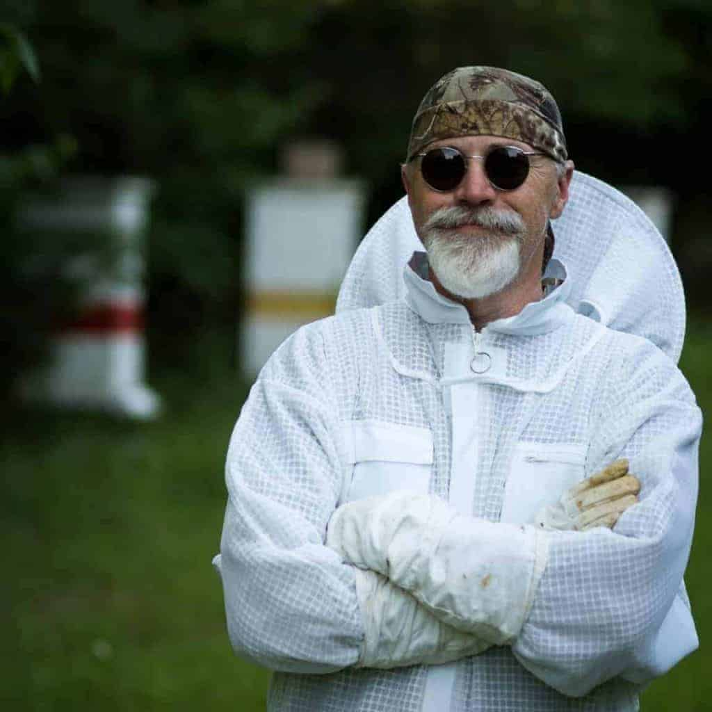 Beekeeper in ventilated suit
